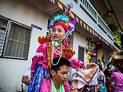 "06 APRIL 2018 - CHIANG MAI, THAILAND:  during the ordination ceremony on the last day of Poy Sang Long at Wat Pa Pao in Chiang Mai. Poy Sang Long (""The Festival of the Crystal Sons"") is a ceremony that marks a rite of passage among the Buddhist Shan people in Myanmar and northern Thailand. Boys between seven and fourteen years of age are ordained as Buddhist novices during a three day ceremony.     PHOTO BY JACK KURTZ"