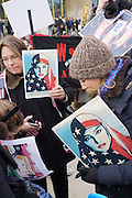 January, 21st, 2017 - Paris, Ile-de-France, France: Women carry 'We the people are greater than fear' placard. Thousands of protesters in Paris join anti-Trump Women's March around the world.