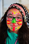 Shangri La is a festival of contemporary performing arts held each year within Glastonbury Festival. The theme for Shangri La, 2015, was protest. Girl wearing glasses dressed up with face paint.