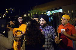 © Licensed to London News Pictures. 10/08/2011. LONDON, UK. A spokesman for the Gurdwara Sri Guru Singh Sabha, part of the largest Sikh temple in Europe, talks to the media about their work to keep the area looter free. Organised, and coordinating with police, members of Southall's Sikh community come out in force to prevent any rioting from taking place in the area. The vigilante action took place as a fourth night of riots and looting were expected to take place in London. Photo credit: Matt Cetti-Roberts/LNP