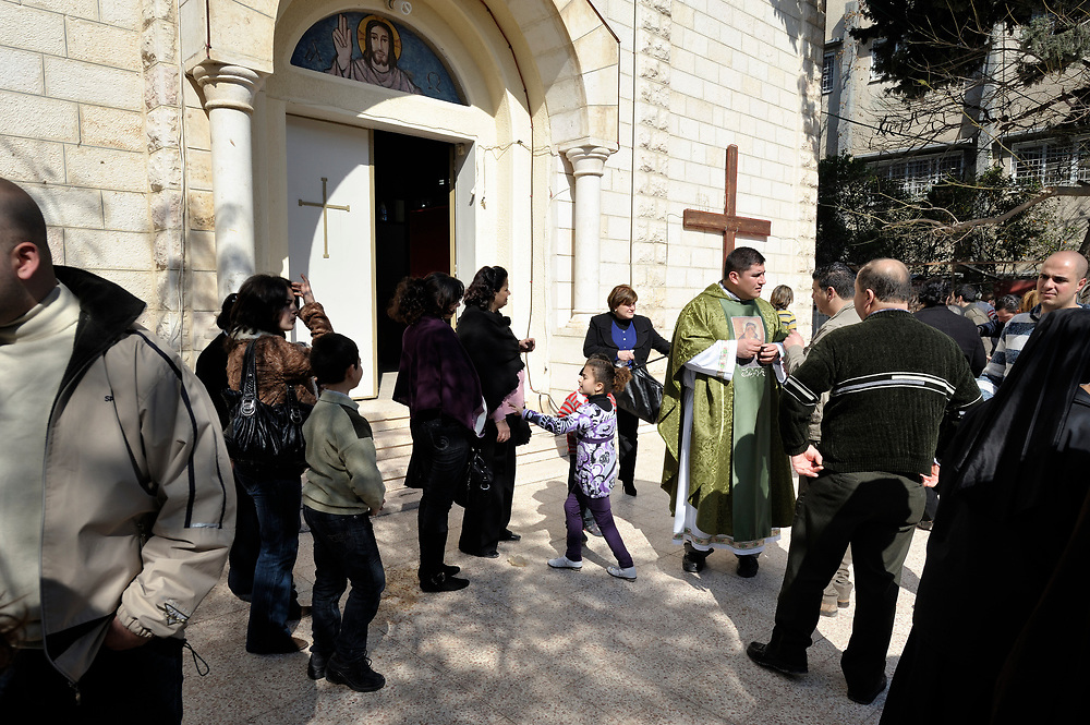 The parish priest, Father Jorge Hernandez, greets Catholics as the gather in front of the Holy Family Catholic Church in Gaza City, following Sunday Mass. There are only some 3,000 Christians in Gaza, of which just 200 are Catholic..