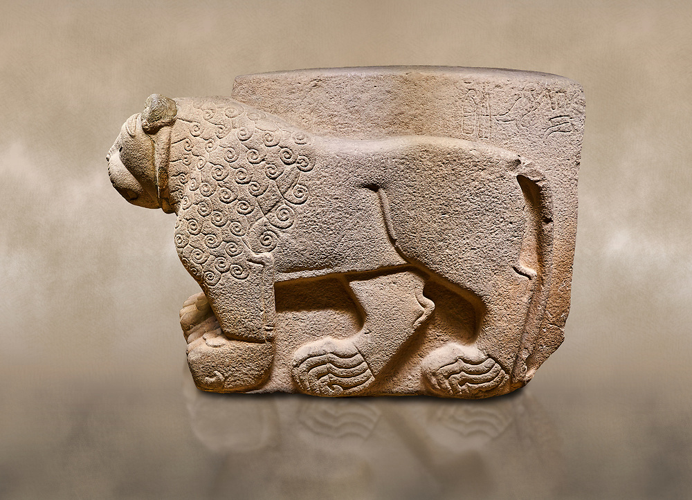 """Hittite relief sculpted stone panel. Lion. Aslantepe Gate Limestone, Aslantepe, Malatya, 1200-700 B.C. Anatolian Civilisations Museum, Ankara, Turkey.<br /> The lion on the left of the two lions at the gate of the palace. His head and his front part were processed as high embossing and his body as regular embossing. The signs behind the lion and over his tail read; """"Halposulupis, Mighty (?) King"""".<br /> <br /> Against a brown art background. <br /> <br /> If you prefer to buy from our ALAMY STOCK LIBRARY page at https://www.alamy.com/portfolio/paul-williams-funkystock/hittite-art-antiquities.html . Type - Aslantepe - in LOWER SEARCH WITHIN GALLERY box. Refine search by adding background colour, place, museum etc.<br /> <br /> Visit our HITTITE PHOTO COLLECTIONS for more photos to download or buy as wall art prints https://funkystock.photoshelter.com/gallery-collection/The-Hittites-Art-Artefacts-Antiquities-Historic-Sites-Pictures-Images-of/C0000NUBSMhSc3Oo"""
