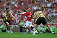 Photo: Tony Oudot/Richard Lane Photography. Arsenal v Juventus. Emirates Cup. 02/08/2008. <br /> Jack Wilshere of Arsenal takes on Olof Mellberg of Juventus