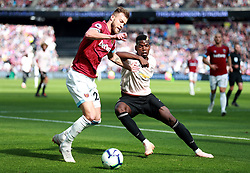 West Ham United's Andriy Yarmolenko (left) and Manchester United's Paul Pogba battle for the ball during the Premier League match at London Stadium.