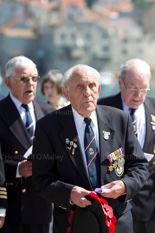 Mcc0031516 . Daily Telegraph..Flt Lt Freddie Nicoll, Reg Ellis and Peter Bickmore BEM...A memorial service on the jetty in the fishing town of Komiza where British forces were based in WWII.. A reunion of British WW2 Veterans, probably for the last time. They are some of the last survivors of an Allied combined garrison of Royal Navy, Royal Marine Commandos, Army and Royal Air Force personnel who took over the Island of Vis in 1943 and held it until the end of the War. From here they harried Axis Forces in what was Yugoslavia, providing supply drops to the Partisans and, at one point, refuge for Marshall Tito when he was nearly captured by German Forces ...19 May 2011 Vis, Croatia