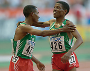 Kenenisa Bekele of Ethiopia embraces countryman Haile Gebrselassie after they finished first and second in the 10,000 meters in the IAAF World Championships in Athletics at Stade de France on Sunday, Aug, 24, 2003.