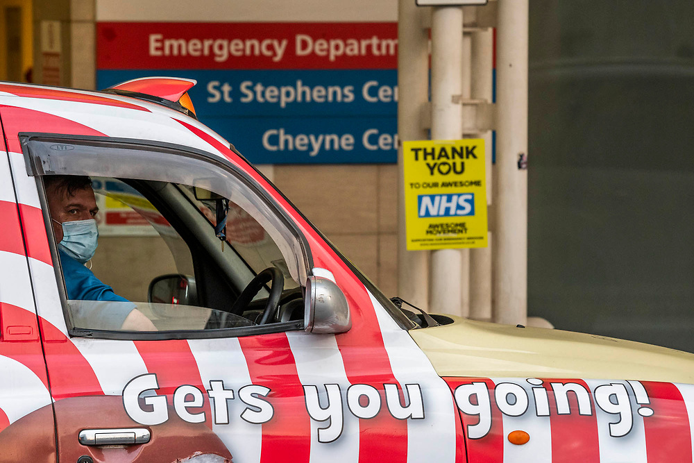 A masked taxi driver waits outside with an appropriate message - Hospital staff come out of Chelsea and Westminster and are greeted by a small but enthusiastic crowd, including several car loads of Met Police Officers - Clap for carers, to say thanks to NHS and other key workers and carers. The 'lockdown' continues in Clapham - Coronavirus (Covid 19) outbreak in London.