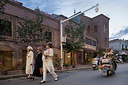 Xinjiang, China. Uighur women walk through the streets oF Kashgar, under close scrutiny of security cameras. <br /> In reaction to the attacks and demonstrations by the muslim minority, tens of thousands of cameras were installed on the streets of every city and village in the province. NATACHA DE MAHIEU