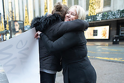 """© Licensed to London News Pictures . 01/12/2018. Manchester , UK . A staff member hugs General Manager ANNE LATHAM (r) upon receiving news that the store is saved . Staff take down """" Closing Down """" signs from the Kendal's House of Fraser department store on Deansgate in Manchester City Centre after a new rental agreement was secured with the landlord . Photo credit : Joel Goodman/LNP"""