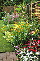 Making a border of annuals<br /> Annual border in flower in summer