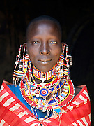 Maasai tribeswoman in traditional clothing, near Amboseli National Park, Rift Valley Province, Kenya