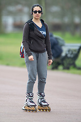 ©Licensed to London News Pictures 02/04/2020  <br /> Greenwich, UK. A lady roller blading. People get out of the house from Coronavirus lockdown to exercise in Greenwich Park, London. Photo credit:Grant Falvey/LNP