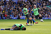 Mitch Pinnock of AFC Wimbledon in action as Kwesi Appiah of AFC Wimbledon lays on the pitch following a strong tackle during the EFL Sky Bet League 1 match between Peterborough United and AFC Wimbledon at London Road, Peterborough, England on 28 September 2019.