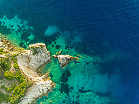 Aerial view of secluded rocky bay on Agios Nikitas, Greece.