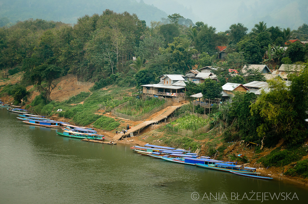 Laos, Nong Khiaw. Nong Khiaw is a small sleepy village at the bank of Nam Ou, one of the most beautiful rivers in Laos.