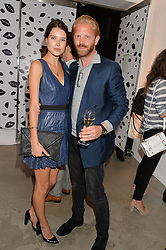 SARAH ANN MACKLIN and ALASTAIR GUY at the launch of The Lulu Perspective to celebrate 25 years of Lulu Guinness held at 74a Newman Street, London on 13th September 2014.