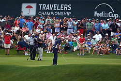 June 24, 2018 - Cromwell, CT, USA - Bubba Watson putts on the 17th green during the final round of the Travelers Championship at TPC River Highlands in Cromwell, Conn., on Sunday, June 24, 2018. (Credit Image: © Brad Horrigan/TNS via ZUMA Wire)