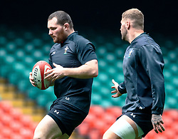 Ken Owens of Wales with team-mate Ross Moriarty<br /> <br /> Photographer Simon King/Replay Images<br /> <br /> Six Nations Round 3 - Captains Run - Wales v England - Saturday 22nd February 2019 - Principality Stadium - Cardiff<br /> <br /> World Copyright © Replay Images . All rights reserved. info@replayimages.co.uk - http://replayimages.co.uk