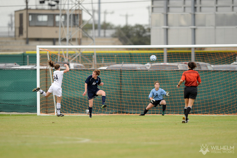 02 DEC 2011: Hannah Weyland (24) of Messiah College heads a goal over Goalkeeper Hilary Barreto (0) of Wheaton College during the Division III Women's Soccer Championship held at Blossom Soccer Stadium hosted by Trinity University in San Antonio, TX. Messiah defeated Wheaton 3-1 to win the national title. © Brett Wilhelm