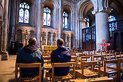 Rob and Ian sitting  inside Peterborough cathedral. They were both recently living on the streets of Peterborough for a number of years.  With belief in their faith and the help of Hope into Action they are now settled into safe and secure housing and are building connections with their families. Peterborough, Cambridgeshire. UK