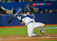 Apr 16, 2015; Toronto, Ontario, CAN; Toronto Blue Jays third baseman Josh Donaldson (20) falls back after being struck by a pitch from Tampa Bay Rays relief pitcher Steve Geltz (not in picture) in the eighth inning at Rogers Centre. Rays beat Blue Jays 4-2, Mandatory Credit: Peter Llewellyn-USA TODAY Sports