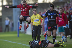December 9, 2018 - Limerick, Ireland - Keith Earls of Munster jumps over Ludovic Radosavljevic of Castres during the Heineken Champions Cup Round 3 match between Munster Rugby and Castres Qlympique at Thomond Park Stadium in Limerick, Ireland on December 9, 2018  (Credit Image: © Andrew Surma/NurPhoto via ZUMA Press)