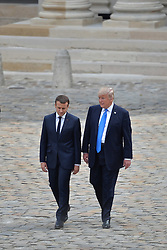 French President Emmanuel Macron welcomes US President Donald Trump at Les Invalides As part of the commemoration of the 100th anniversary of the entry of the United States of America into World War I on July 13, 2017 in Paris, France. Photo by Lionel Hahn/ABACAPRESS.com