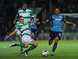 QPR's Tyler Blackett is tackled by Yeovil Town's Connor Roberts - Photo mandatory by-line: Harry Trump/JMP - Mobile: 07966 386802 - 11/08/15 - SPORT - FOOTBALL - Capital One Cup - First Round - Yeovil Town v QPR - Huish Park, Yeovil, England.