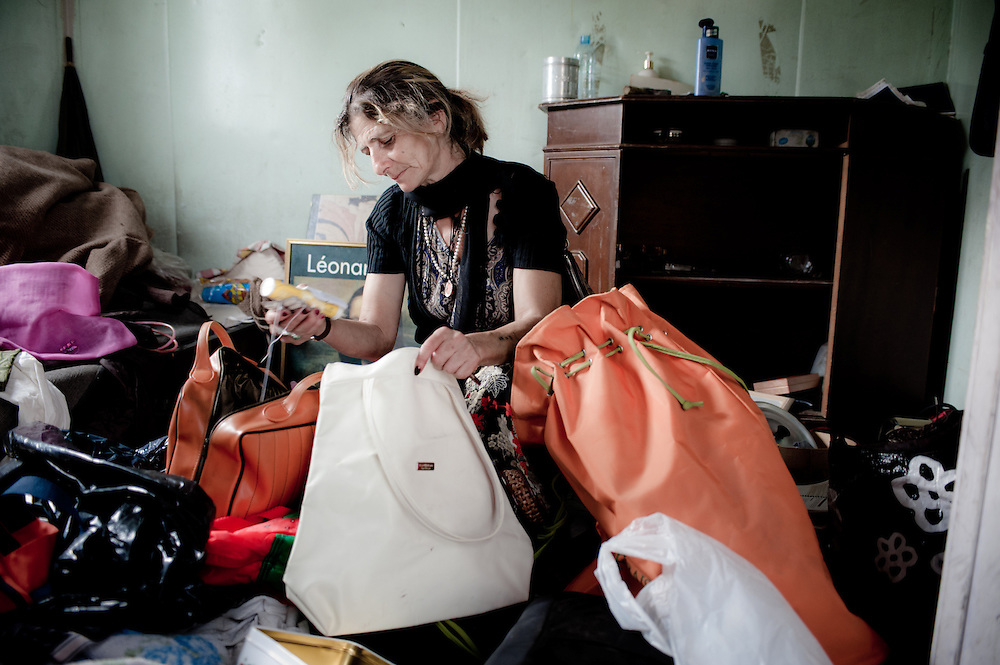 Rome, Italy - 28 September 2012: a Bosnian woman gathers her possessions minutes before being forcibly evicted from her barrack in the Tor de' Cenci camp. Human rights associations argue that the eviction happened with no sufficient notice for the people and that the majority of residents are not willing to relocate.