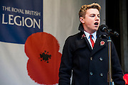 Collabro sing and add their poppies to the fountains. A remembrance event in Trafalgar Square included a two minute silence and poppies being placed in the fountains.