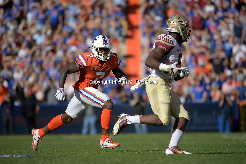 Florida defensive back Duke Dawson (7) pursues after Florida State running back Jacques Patrick (9) catches a pass during the second half of an NCAA college football game Saturday, Nov. 25, 2017, in Gainesville, Fla. FSU won 38-22. (Photo by Phelan M. Ebenhack)