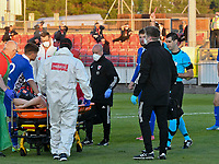 Football - 2023 UEFA U21 Championship - Qualifying - Group E - Wales vs Moldova - Steboneath Park, Llanelli<br /> <br /> referee Mr De Gabriele  shows the red card to Sion Spence Wales as  he is stretchered off<br /> <br /> COLORSPORT/WINSTON BYNORTH