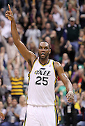 Utah Jazz center Al Jefferson reacts after scoring against the Los Angeles Lakers during the second half of an NBA basketball game, Saturday, Feb. 4, 2012, in Salt Lake City. Jefferson scored 18 points in Utah's 96-87 win. (AP Photo/Colin E Braley).