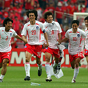 Republic of Korea's players celebate their win over Spain