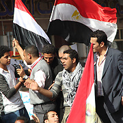 A small tussle breaks out as young men rally the crowd during the Day of Justice and Cleansing in Cairo's Tahrir Square.