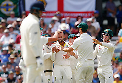 Australia's Nathan Lyon celebrates after taking the wicket of England's Joe Root during day four of the Ashes Test match at the WACA Ground, Perth.