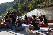 A host home team meeting, Bukhel, Nepal.  ICS / Restless Development volunteers in the Dakshinkali region of Nepal. (© Andy Aitchison / ICS)