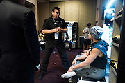 LAS VEGAS, NV - JULY 8:  John McCarthy goes over the rules with Claudia Gadelha in her locker room before The Ultimate Fighter Finale at MGM Grand Garden Arena on July 8, 2016 in Las Vegas, Nevada. (Photo by Cooper Neill/Zuffa LLC/Zuffa LLC via Getty Images) *** Local Caption *** John McCarthy; Claudia Gadelha