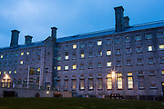 Cell windows at night. HMP/YOI Portland, a resettlement prison with a capacity for 530 prisoners. Dorset, United Kingdom.