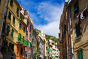 Narrow street and colorful houses in Riomaggiore, Cinque Terre, Liguria, Italy