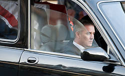 © London News Pictures. 10/03/2012.  Newcastle, UK. Darren Rathband brother of PC David Rathband driving the hearse away fromNewcastle Cathedral in Newcastle upon Tyne for a formal police memorial service in the memory of PC David Rathband, who was found dead in his Northumberland Home on February 29. PC David Rathband was left blind after being shot in the face by gunman Raoul Moat.  Photo credit : Ben Cawthra/LNP
