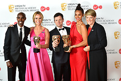 Sir Mo Farah and Clare Balding presenting Amanda Holden, Declan Donnelly and Alesha Dixon, with the BAFTA for Entertainment Programmes for BGT, at the Virgin TV British Academy Television Awards 2018 held at the Royal Festival Hall, Southbank Centre, London.