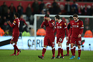 Roberto Firmino of Liverpool (9) and his Liverpool teammates walk off dejected at the end of the game.  Premier league match, Swansea city v Liverpool at the Liberty Stadium in Swansea, South Wales on Monday 22nd January 2018. <br /> pic by  Andrew Orchard, Andrew Orchard sports photography.