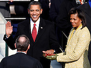 Barack Obama takes the Oath of Office as the 44th President of the United States as he is sworn in by U.S. Chief Justice John Roberts with his wife Michelle By his side during the inauguration ceremony in Washington January 20, 2009.  REUTERS/Jim Young