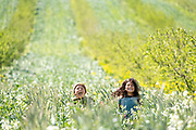 Ward and Marianna frolicking in the organic cover crops at Burroughs Family Farms