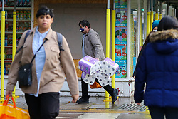 © Licensed to London News Pictures. 31/10/2020. London, UK. A shopper carrying packs of toilet rolls in north London as panic buying begins. Prime Minister Boris Johnson has met his Cabinet this afternoon ahead of a press conference at 5pm, amid reports that the government is poised to impose a second national lockdown in England from Wednesday.  Photo credit: Dinendra Haria/LNP