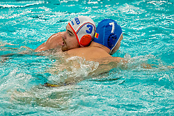 Jorn Winkelhorst of the Netherlands in action against Gabriel DragomirescuVlad of Romania during the Olympic qualifying tournament. The Dutch water polo players are on the hunt for a starting ticket for the Olympic Games on February 16, 2021 in Rotterdam