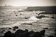 Piedra Blancas Lighthouse and rocky coastline, San Simeon, California USA