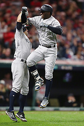 October 11, 2017 - Cleveland, OH, USA - The New York Yankees' Gary Sanchez, left, and Didi Gregorius celebrate Gregorius' two-run home run against the Cleveland Indians in the third inning during Game 5 of the American League Division Series, Wenesday, Oct. 11, 2017, at Progressive Field in Cleveland. (Credit Image: © Phil Masturzo/TNS via ZUMA Wire)