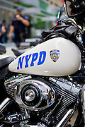 New York City: NYPD motorcycle cops take a coffee break by their Harley Davidsons